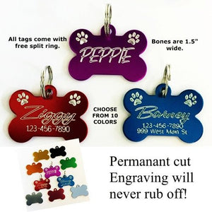 These personalized bone shaped dog tags has etched paw prints.