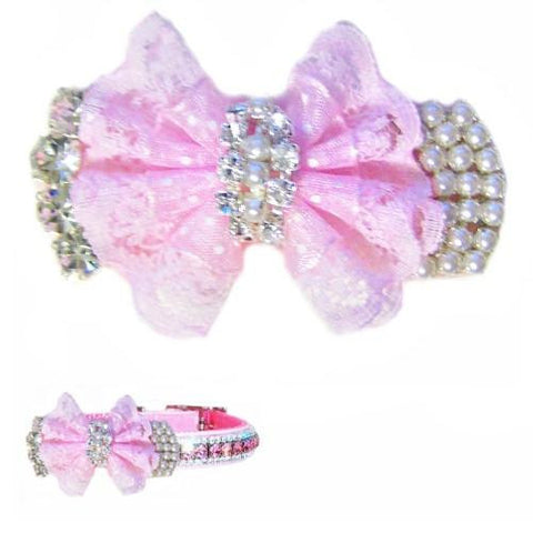 A beautiful pet collar accessory with a pink bow, crystals and faux pearls.