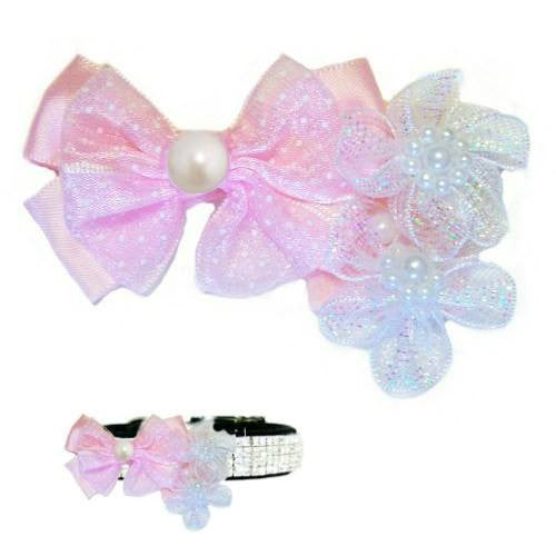 A pet collar accessory with pink bow, white flowers and pearls.