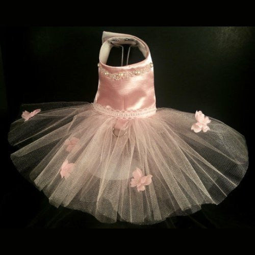 This lovely pastel pink dog tutu dress features pearl embellished butterflies on the skirt.