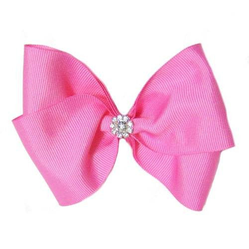 A large dog hair bow in pink with a rhinestone flower embellishment.