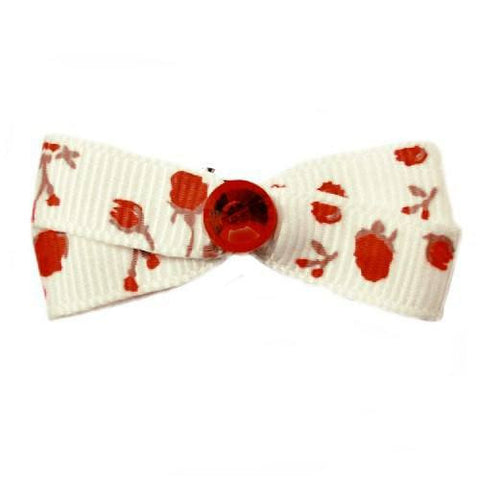 A lovely roses printed small dog hair bow with a pretty red crystal in the center.