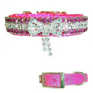 This special pink girl dog collar has a crystal bow.