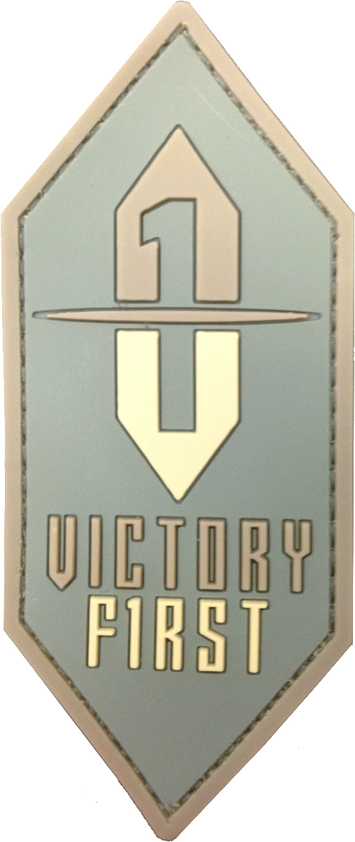 Victory First Logo Patch in subdued earth tones for lower profile while wearing earth tones or various military colors, such as; Multicam® Coyote, Desert Sand, or Olive Drab. Patch made of soft 3D PVC in 3 colors, with Velcro hook backing. Made in the USA