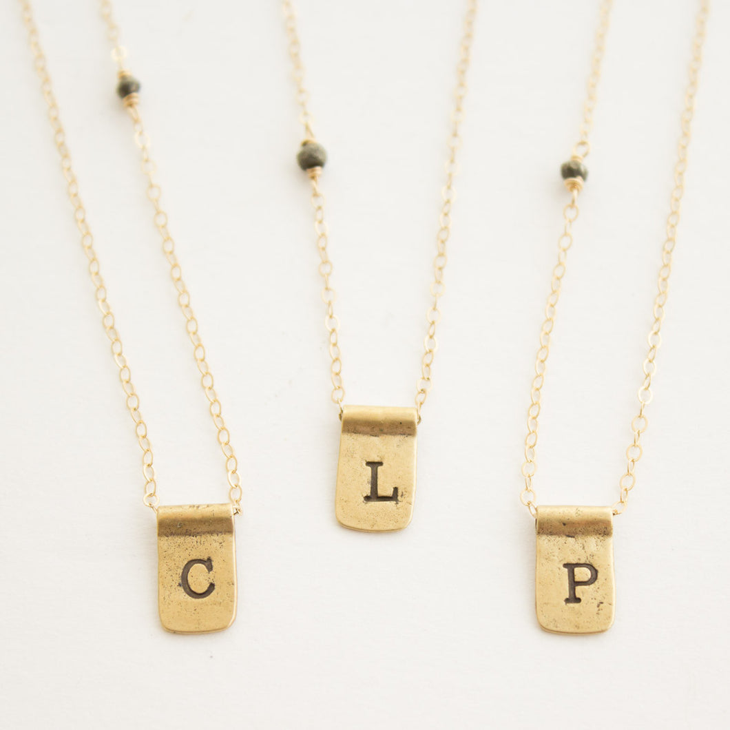 TAB LETTER NECKLACE