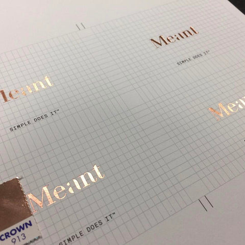 Meant's logo gold foil