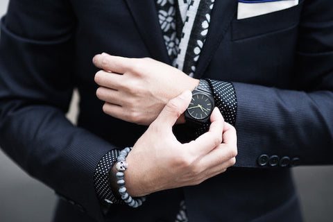 man in suit who matched his watch to his outfit