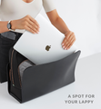 Woman placing computer into black Sparro Designs laptop pocket