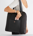 Sparro Designs Neoprene work and gym tote on shoulder of fashionable women placing phone into front pocket