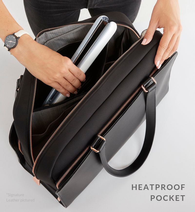 Hair straightener being placed into heatproof pocket of black work and gym tote