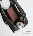 Opened black work bag filled with daily #LifeInBag essentials
