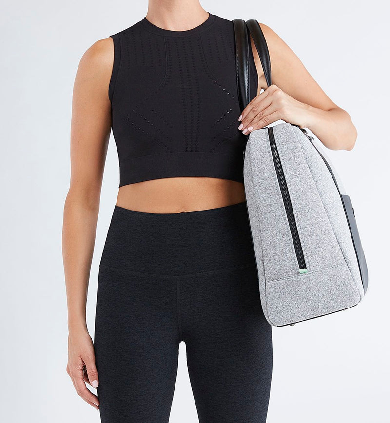 Woman in black tights and crop carrying stylish Sparro Designs Grey and Black work and gym carry-all