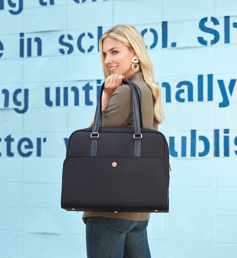 Blonde woman holding stylish black neoprene laptop and gym tote