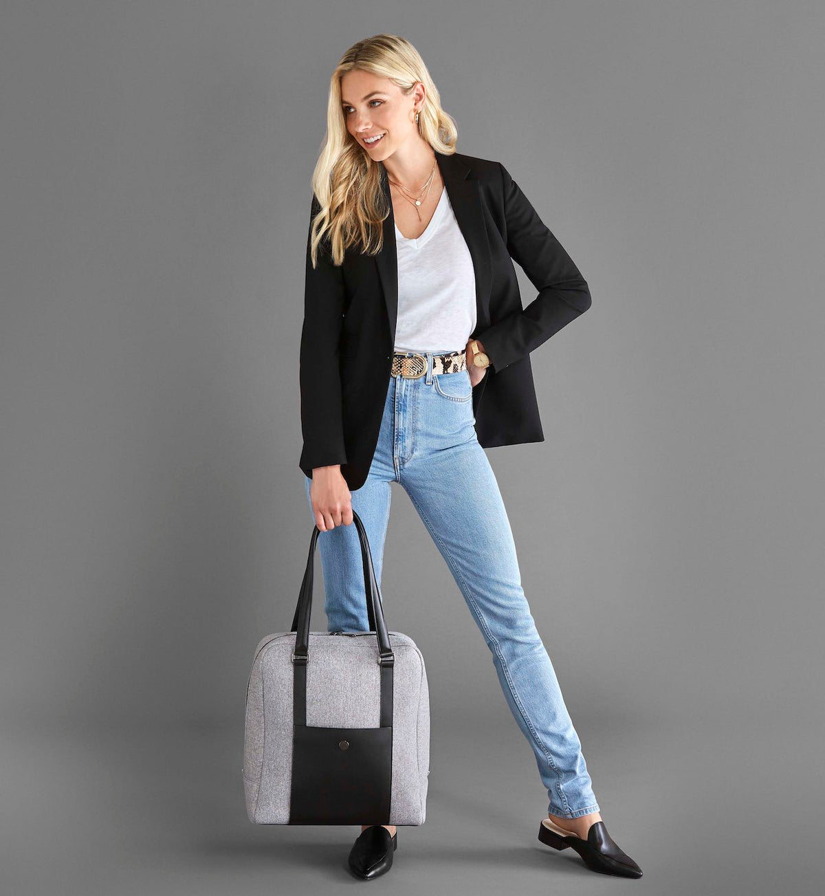 Woman holding fashionable Neoprene grey and black work and gym tote
