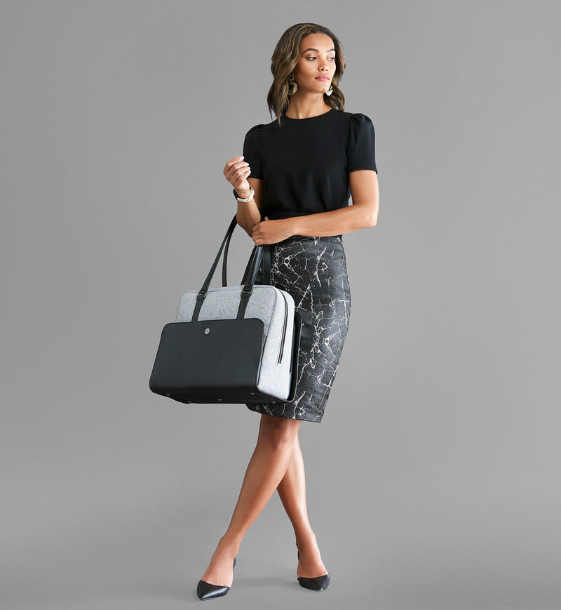 Fashionable woman holding Sparro Designs grey and black work bag