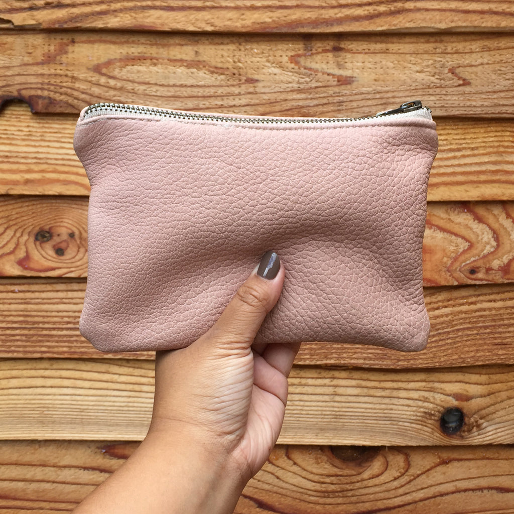 Leather pouch in blush pink color with zipper and leather pull