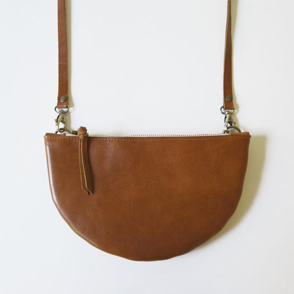 Half Moon Leather Crossbody Bag in Cognac