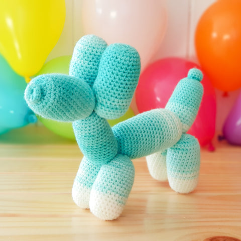 Teal puppy balloon animal.