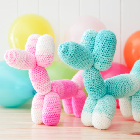Teal and pink puppy balloon animals.