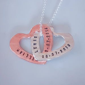 interlocking personalized hearts, handmade from sterling silver and copper with a hammered effect