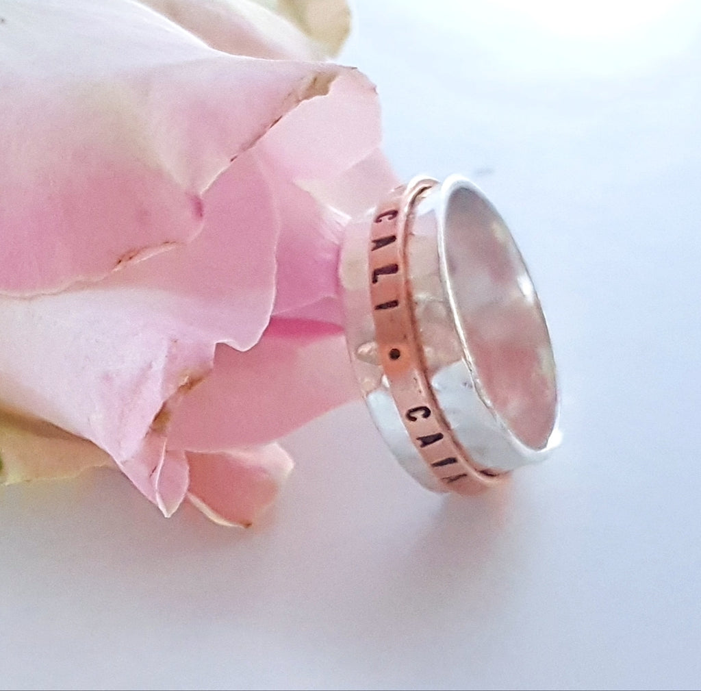 hammered silver ring with a personalized copper ring that spins around the ring
