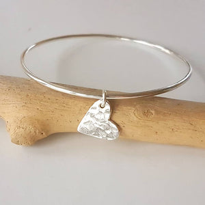 silver heart bangle, handmade silver bangle with hammered heart shaped hanging charm