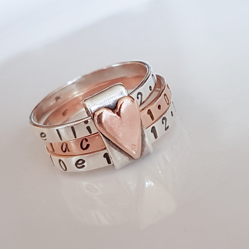 silver personalized stacking ring with 9ct rose gold centred in between 2 sterling silver rings