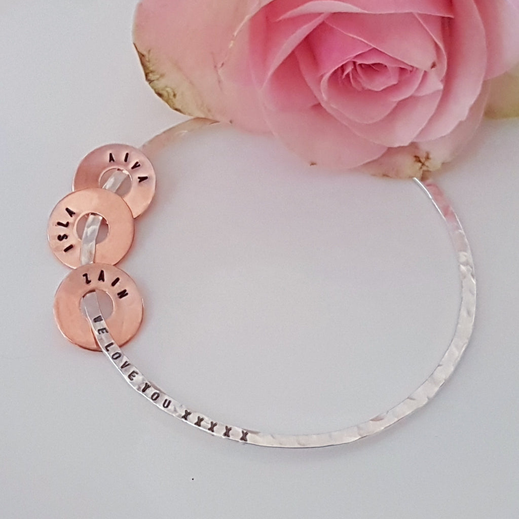 silver personalized name bangle with moving personalized copper disc