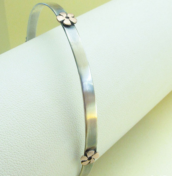 Silver bangle with copper daisy flowers - Red Ted's Jewellery