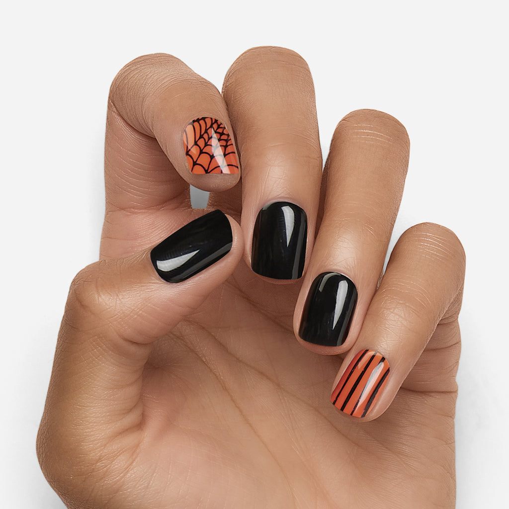 Boo! We're here to make your Halloween a bit more glam with some seriously spooky press on nails. After all, what's Halloween without the drama and sparkle?