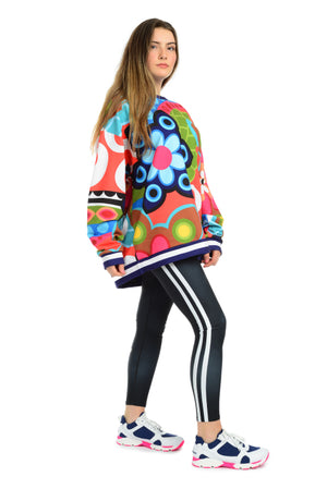 Oversized sweatshirt. Large bold floral pattern. great, fun fashionable vacation style
