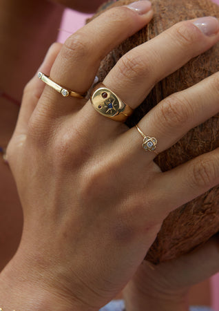 Endless Knot Ring in Gold with Diamonds