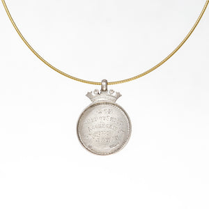 Antique sterling and gold round shooting medal necklace