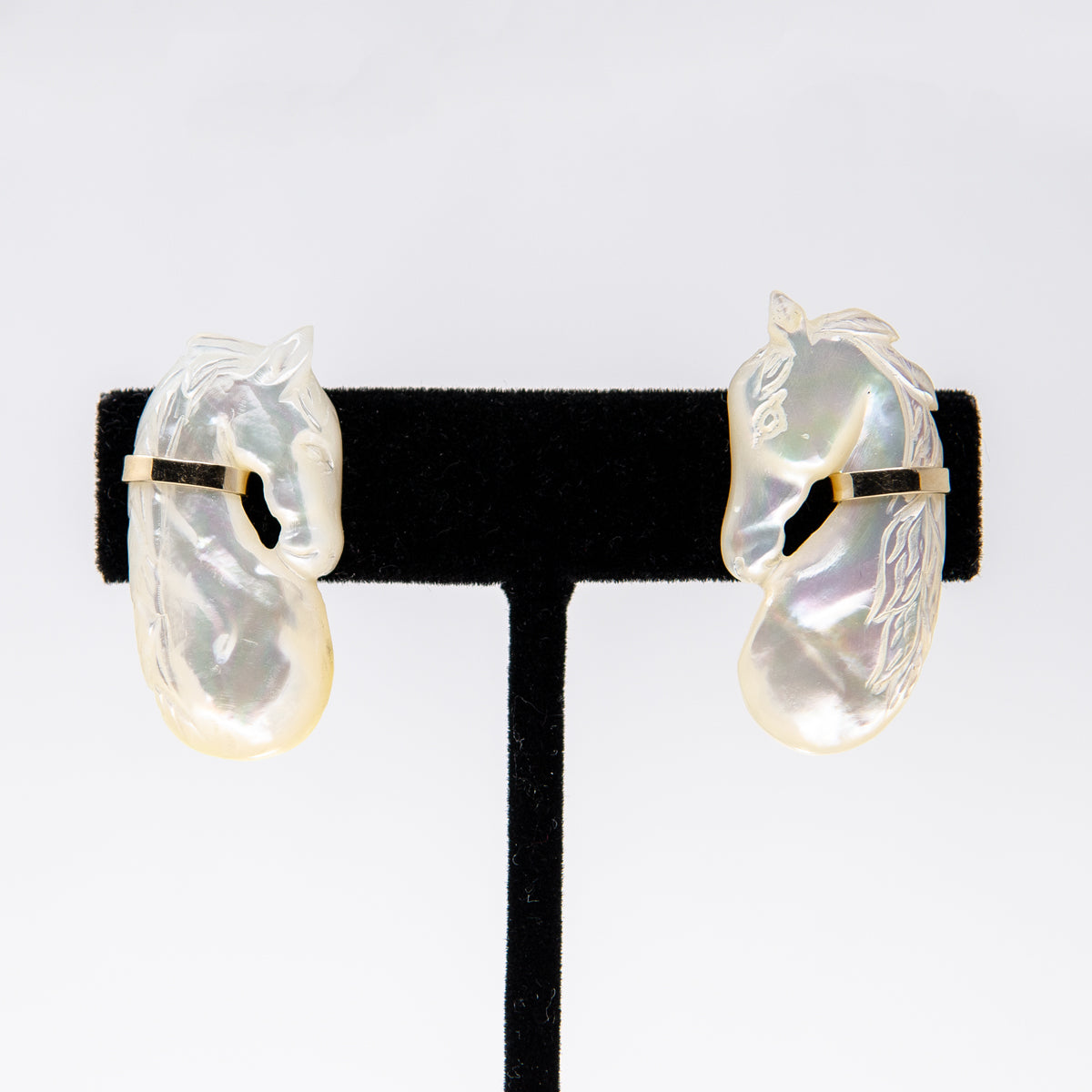 Mother-of-pearl pair of horse earrings