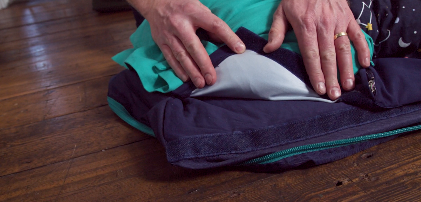 The waterproof sheet on the Kids' Travel Bed with a jersey cotton upper and waterproof protective bottom layer