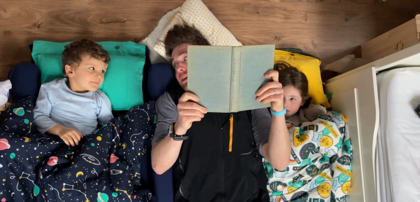 Storytime with two toddlers cosy in their Tot-to-Ten Travel Beds