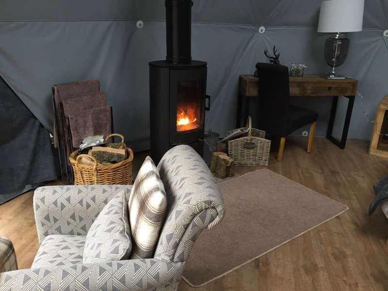 Woodland Escapes Geodome and wood burning stove on Cool Camping