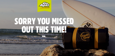 Surfboard and Bundle Bed on the beach to advertise Go Ape competition