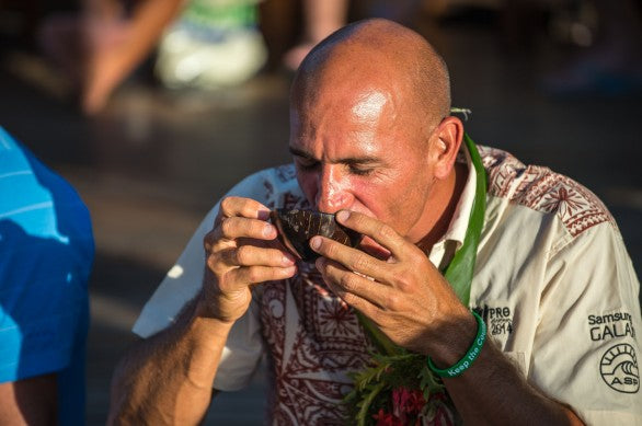 Kelly Slater participating in the traditional kava ceremonies.