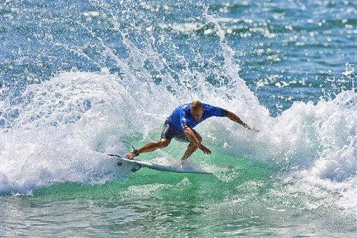 Kelly Slater pushing the tail all the way around.