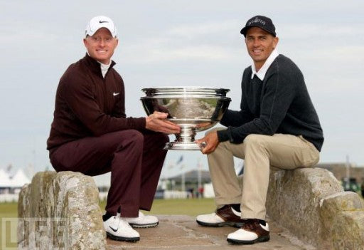 Kelly Slater and Simon Dyson Hold up their First Place Trophy aththe 'Afred Dunhill Links' golf course.