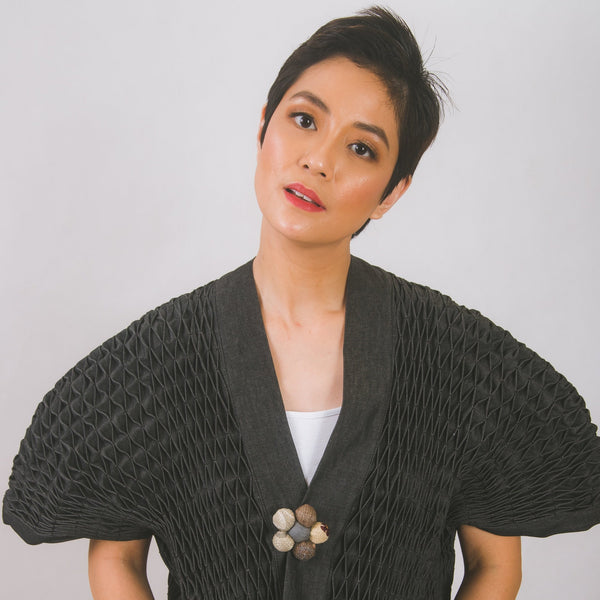 Hand-smocked kimono in black denim