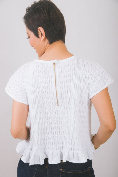 Hand-smocked top in white piqué