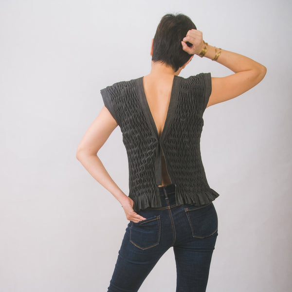 Hand-smocked vest in black denim