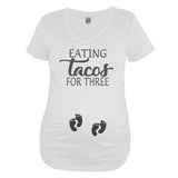 White Eating Tacos For Three Maternity V Neck With Two Sets Of Baby Foot Prints On Belly - It's Your Day Clothing