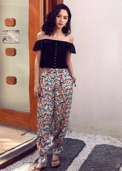 Black Off Shoulder Top with Geometric Pants