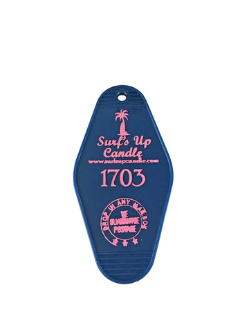 Surfs Up Candle navy hotel key chain with pink print.