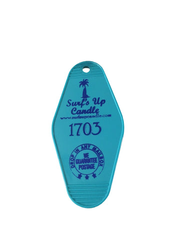 Surfs Up Candle Turquoise hotel key chain with navy print.