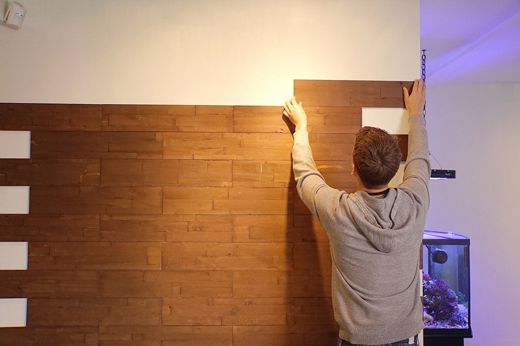 Line up the edge with the wall for less cutting