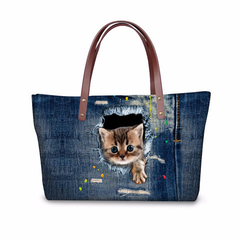 Cute Cat Tearing Through Blue Denim Handbag
